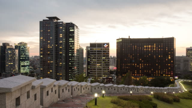 night scenery of the hilton hotel and many built structures from the baekbeomgwangjang plaza - la via giusta video stock e b–roll