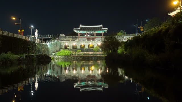 night scenery of the hwahongmun gate and pond at the suwon hwaseong castle - suwon stock videos and b-roll footage