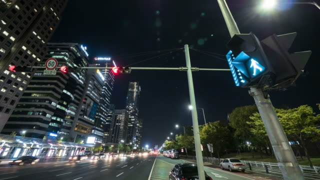 Night scenery of the Yeouido Transportation Centre and traffic moving on the street