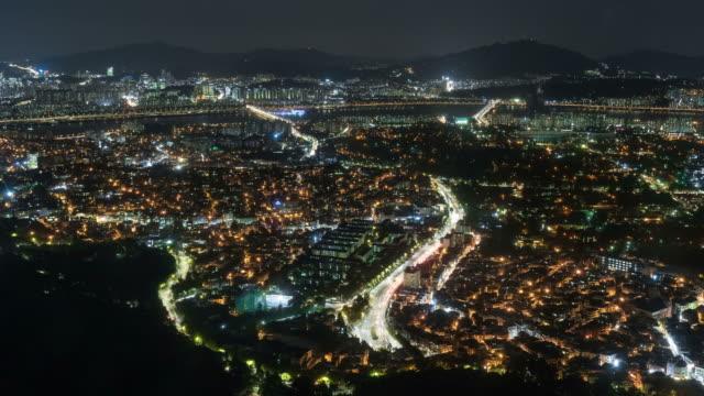 night scenery of the yongsan-gu area and han river - 乗り物の明かり点の映像素材/bロール