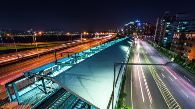 Night scenery of traffic moving at Gangbyeonbungno express way near Subway Station in Hannam-dong
