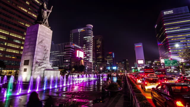 Night scenery of Yi Sunsin(historic naval commander) bronze statue and traffic moving at Gwanghwamun Square