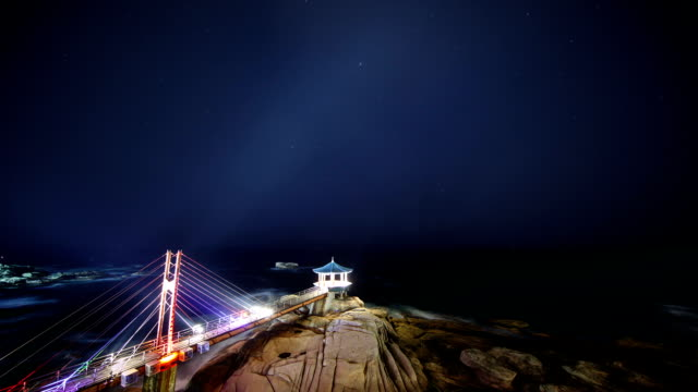night scenery view of a bridge and yeonggeumjeong (observation point) in dongmyeong-port, sokcho (famous travel destination for summer vacation) - meteor shower stock videos and b-roll footage