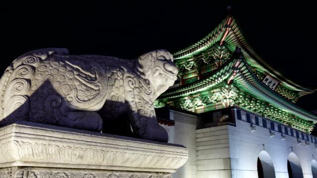Night Scenery view of a Haetae (Mythical Unicorn-Lion) stone statue near Gwanghwamun gate in Jongno-gu