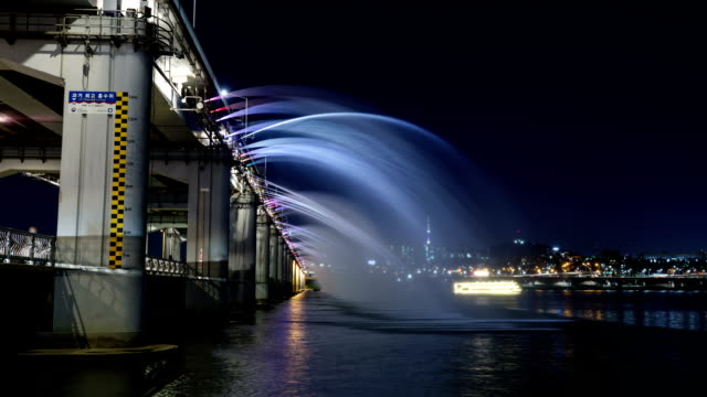 night scenery view of moonlight rainbow fountain (famous tourist destination) - spraying stock videos & royalty-free footage