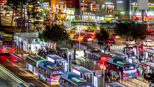 Night scenery view of traffic moving and people waiting at Seoul Station Bus Transfer Center