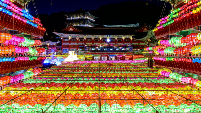 night scenery view of yeondeunghoe festival (a lighting ceremony to celebrate buddha's birthday) at samkwangsa temple (largest buddhism temple in busan) - buddha's birthday stock videos and b-roll footage