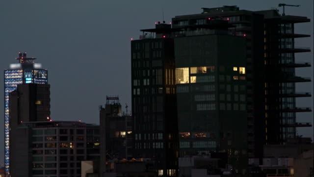 vidéos et rushes de night shot from mexico city modern skyline - mexico