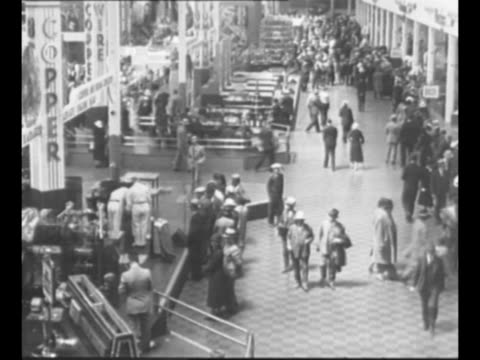stockvideo's en b-roll-footage met night shot of ford building at century of progress exposition the 1933 world's fair / montage fair attendees look at exhibits / diorama turns... - 1933