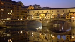 Night shot of illuminated Ponte Vecchio bridge and Arno River in Florence, Italy
