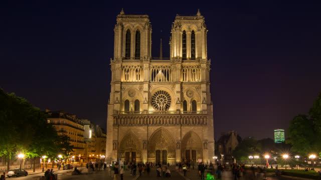 t/l ws la night shot of notre dame in paris, france - notre dame de paris stock videos and b-roll footage