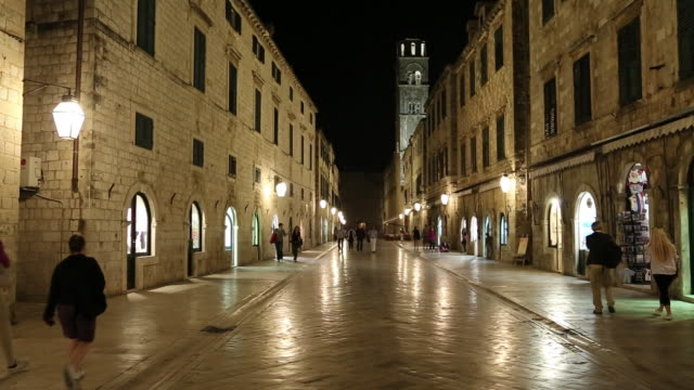 Night shot of people walking on Stradun street, Dubrovnik