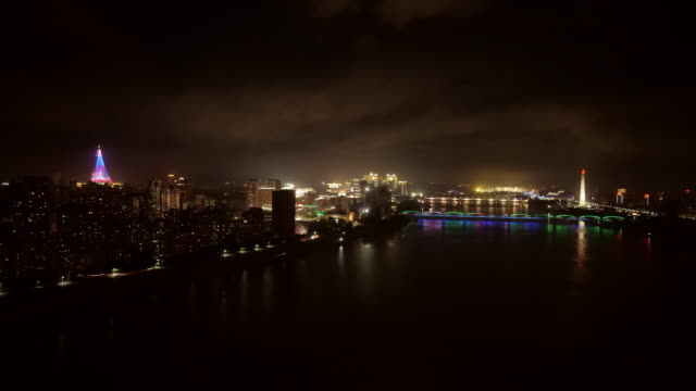 night shot of skyline of pyongyang north korea, drpk. wide shot from above with juche tower, taedong river and ryugyong hotel (pyramid) - spoonfilm stock videos and b-roll footage