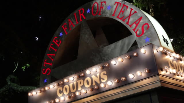 Night shot of Texas State Fair ticket booth with flashing lights