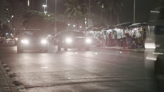 night shot of traffic in copacabana. - copacabana stock videos & royalty-free footage