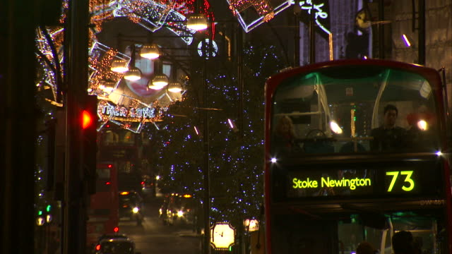 night shot panning up to the christmas lights decorating london's oxford street. - oxford street london stock videos and b-roll footage