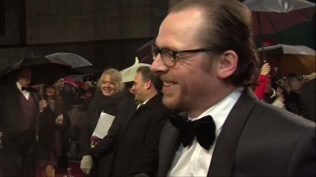 Night shot Simon Pegg talking to press on red carpet British Academy Film Awards at The Royal Opera House on February 10 2013 in London England