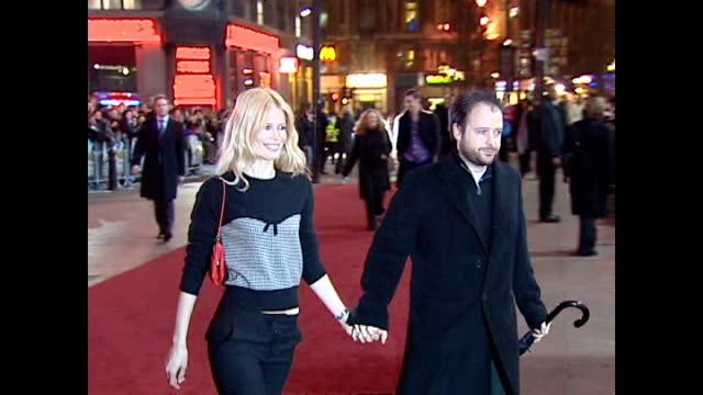 Night shots Claudia Schiffer and husband Matthew Vaughan arrive on January 18 2004 in London England