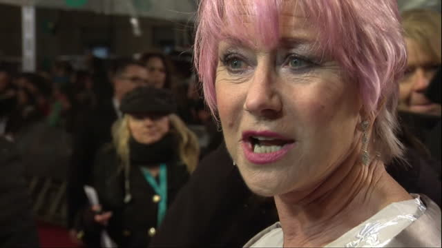 stockvideo's en b-roll-footage met night shots dame helen mirren on red carpet talking to press british academy film awards at the royal opera house on february 10 2013 in london... - bafta awards