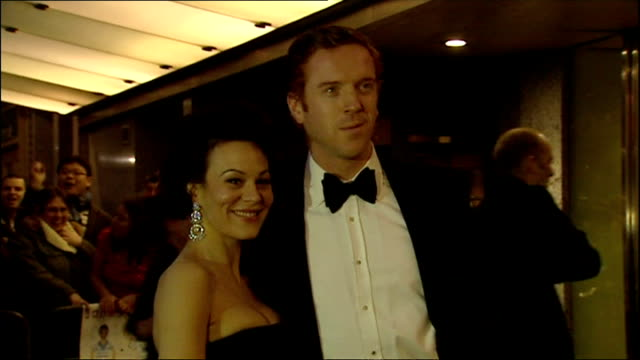 night shots damian lewis and wife helen mccrory pose on red carpet upon arrival at olivier awards - ヘレン マックローリー点の映像素材/bロール