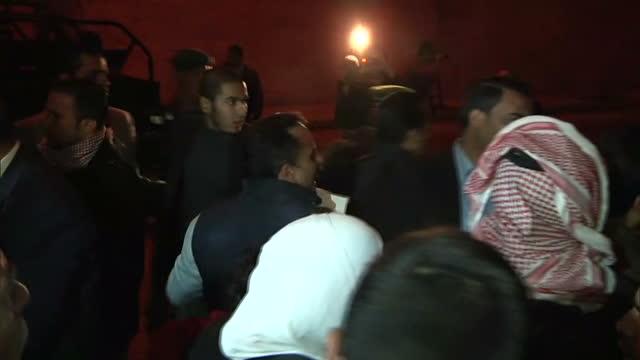 night shots female relatives of captured jordanian pilot mu'ath al-kaseasbeh walk through crowds outside palace / night shots crowds of angry men... - terrorism stock videos & royalty-free footage