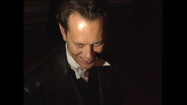 night shots of actor richard e grant giving an interview at the film premiere of spice world on december 15, 1997 in london, england. - richard e. grant stock videos & royalty-free footage