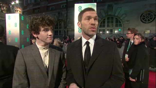 night shots of animator travis knight actor art parkinson talking about working on the film kubo and the two strings on february 12 2017 in london... - animator stock videos & royalty-free footage