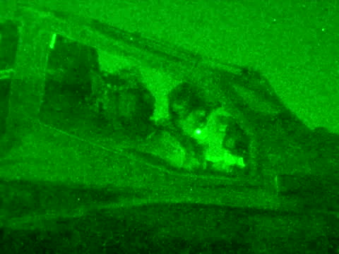 night shots of captain wales prince harry sitting in apache helicopter cockpit preparing for flight doing preflight checks prince harry sitting in... - apache helicopter stock videos and b-roll footage