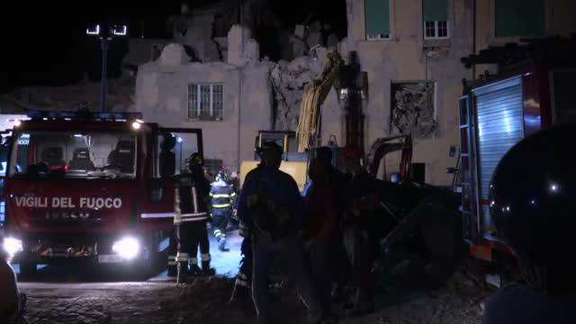 Night shots of emergency rescue workers searching through the rubble for survivors with cranes on August 24 2016 in Amatrice Italy