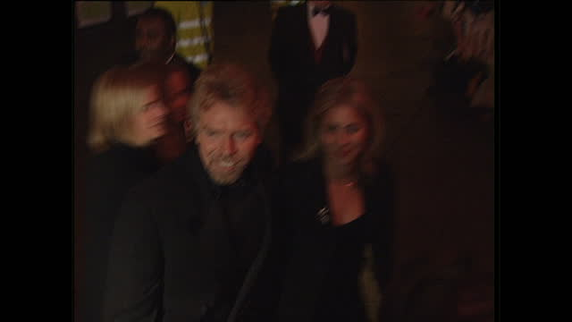 night shots of entrepreneur businessman richard branson arriving with his family briefly speaking to the press at the film premiere of spice world on... - geri horner stock videos & royalty-free footage