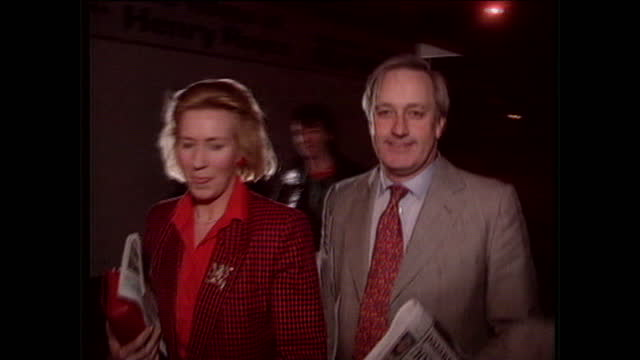 night shots of neil hamilton and his wife christine departing and being followed by press probing for answers on the cash for questions scandal neil... - christine last stock-videos und b-roll-filmmaterial