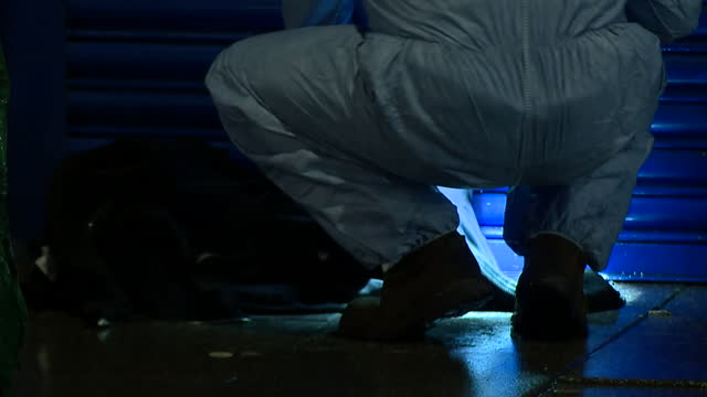 night shots of police forensics officer at stabbing crime scene - forensic science stock videos & royalty-free footage