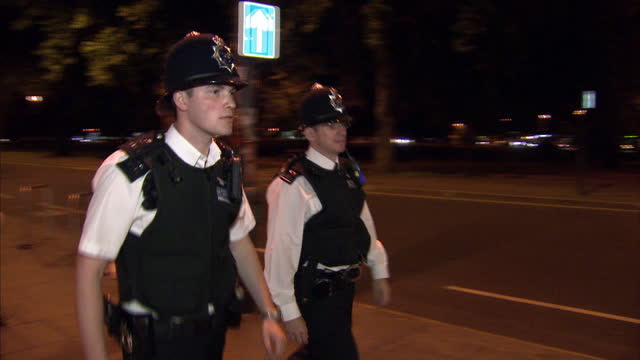Night shots of police officers patrolling the streets of Shepherds Bush during the 5th day of rioting around the country on August 10 2011 in London...