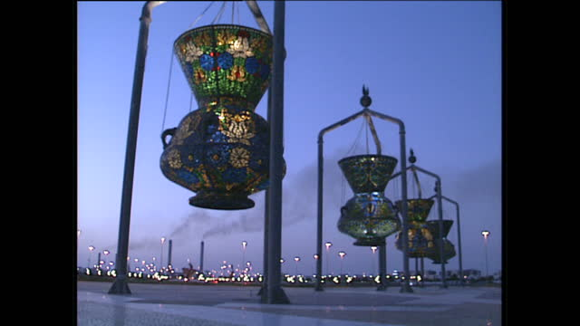 night shots of public art on roundabouts, including the mameluke lanterns and the illuminated globe, both by julio lafuente, the supplication... - jiddah stock videos & royalty-free footage
