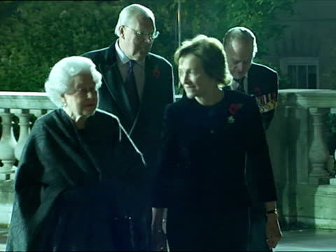 night shots of queen elizabeth ii meeting officials and guests outside the royal albert hall for the festival of remembrance the queen attends the... - queen elizabeth hall stock videos and b-roll footage