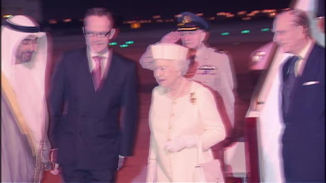 night shots of queen elizabeth ii & prince phillip, duke of edinburgh arrive at abu dhabi airport and are greeted by abu dhabi crown prince sheikh... - シャイフ点の映像素材/bロール
