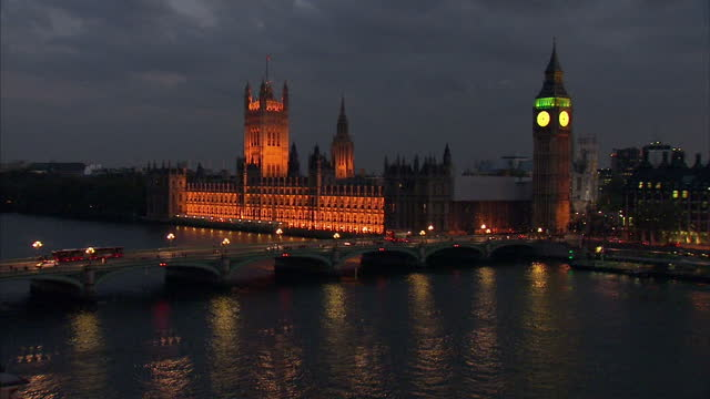 night shots of the houses of parliament the big ben clock and westminster bridge over the thames river on may 6 2010 in london england - westminster bridge stock-videos und b-roll-filmmaterial
