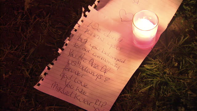stockvideo's en b-roll-footage met night shots of tribute candles notes outside the flat of missing boy mikaeel kular on in edinburgh united kingdom - vermiste personen