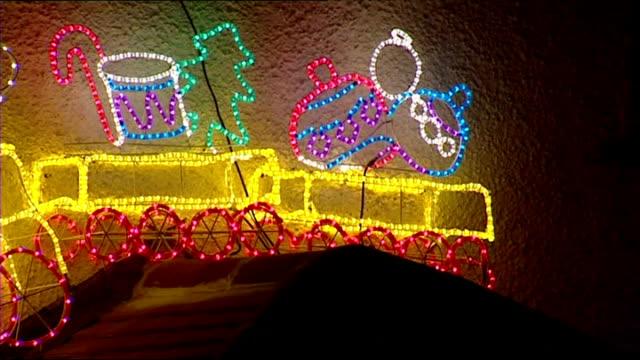 Night shots tacky Christmas lights flashing on side of house