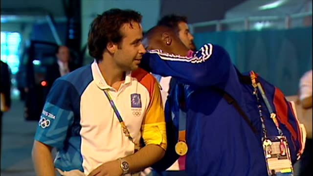 night shots team gb medal winners milling around, chatting to press. includes kelly holmes with gold medals on august 14, 2004 in athens, greece. - athens greece stock videos & royalty-free footage