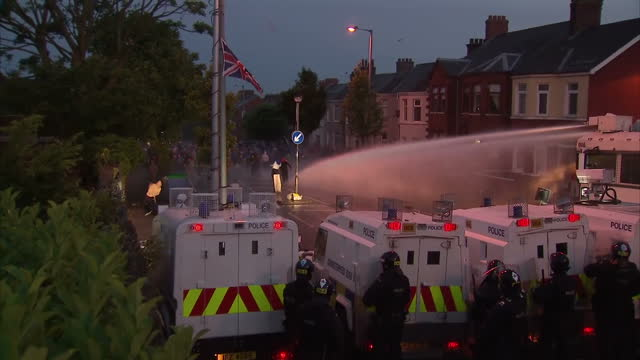 night shots water cannon being deployed police lines being pelted night shots fire from petrol bomb interview brian rowan security analyst night... - belfast stock videos & royalty-free footage