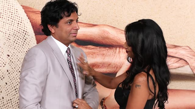 """stockvideo's en b-roll-footage met night shyamalan and bhavna vaswani attend the """"old"""" new york premiere at jazz at lincoln center on july 19, 2021 in new york city. - première"""