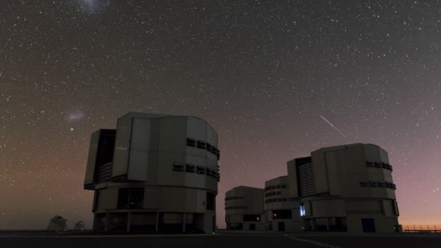 night sky above very large telescope - observatorium stock-videos und b-roll-filmmaterial