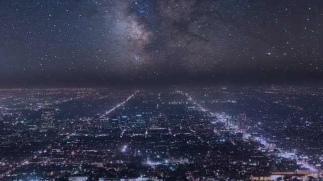 night sky milky way over city of los angeles - thoroughfare stock videos & royalty-free footage