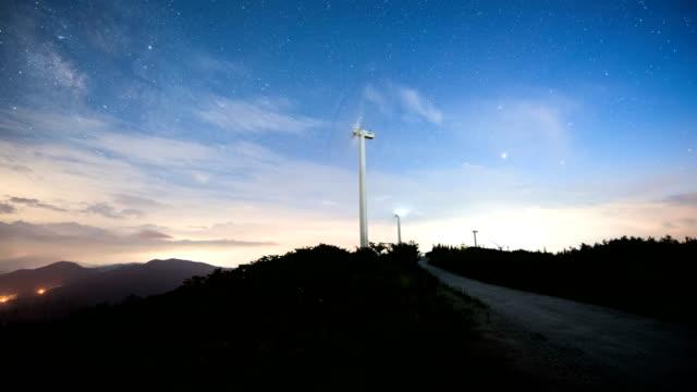 night sky of wind power complex / gangwon-do, south korea - wind turbine stock videos & royalty-free footage