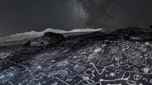 night sky over ancient petroglyph sky rock - astronomy stock videos & royalty-free footage