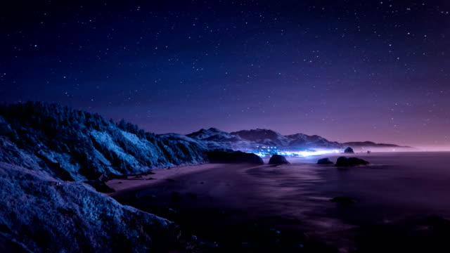 night sky over cannon beach on the oregon coast - cannon beach stock videos & royalty-free footage