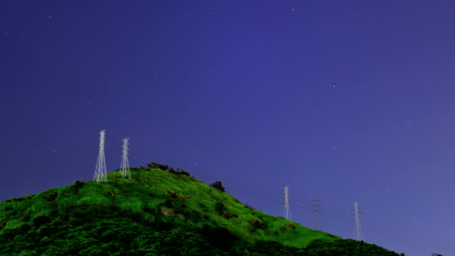 Night Sky Time Lapse over Electricity Towers on a mountain in Rio de Janeiro
