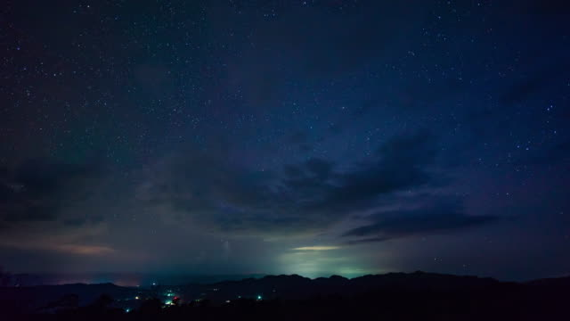t/l night sky with lighting storm - dramatic sky stock videos & royalty-free footage