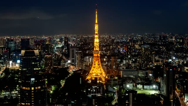 Night skyline of Time lapse of Tokyo city skyline at night with Tokyo Tower and skyscrapers illuminated at summer, Tokyo, Japan.